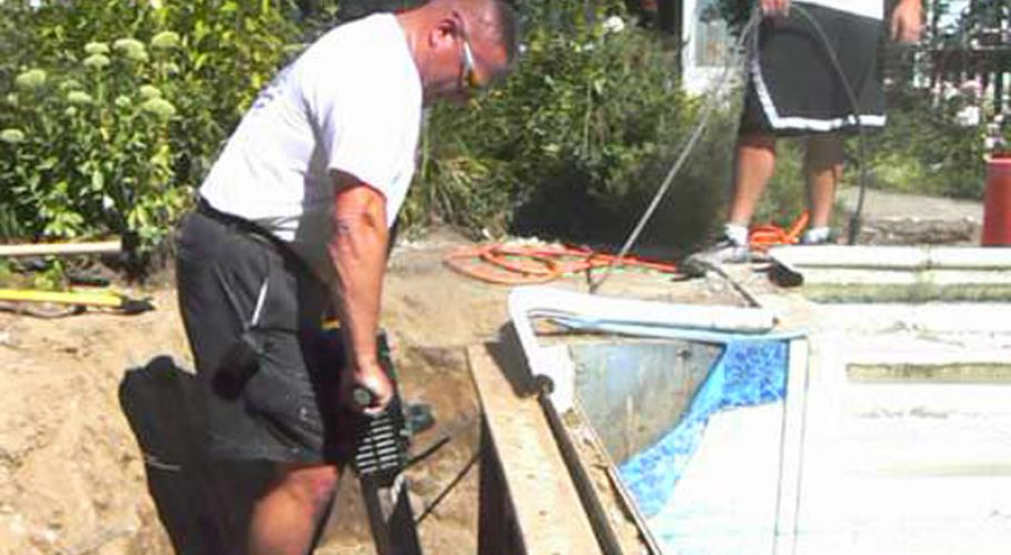 Removing the concrete footing on a rusted steel wall Pool